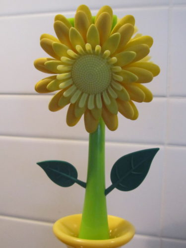 ... som föreställer en blomma.